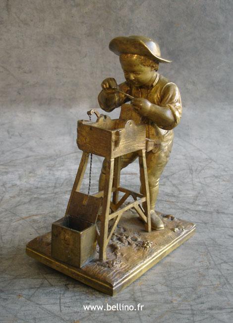 Le rémouleur de Charles menne en bronze
